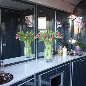 The interior of a luxury toilet trailer supplied by Barny Lee Marquees for weddings and events