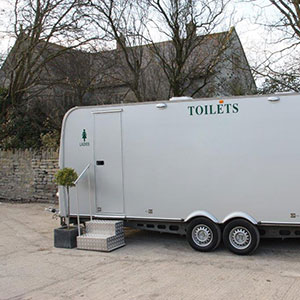 A luxury toilet trailer supplied by Barny Lee Marquees for weddings and events in Southern England